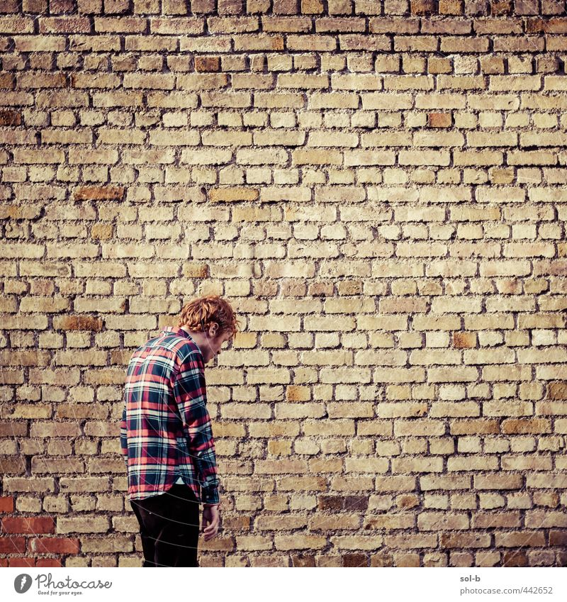 reject Human being Youth (Young adults) City Loneliness Adults Young man 18 - 30 years Warmth Wall (building) Sadness Wall (barrier) Orange Masculine Tall Shirt Fatigue