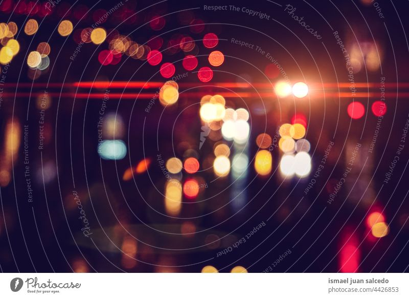 defocused multicolored street lights at night in the city colors colorful bokeh circles bright shiny blur blurred outdoors abstract pattern background glow
