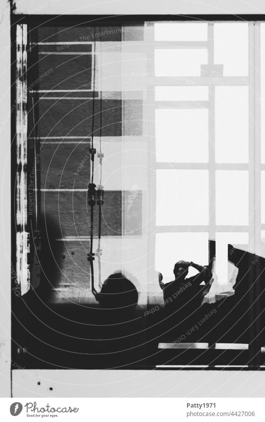 Human silhouettes in front of a geometric facade reflected in a glass pane Silhouette Human being Window Slice spitting Abstract Photographer Reflection Pane