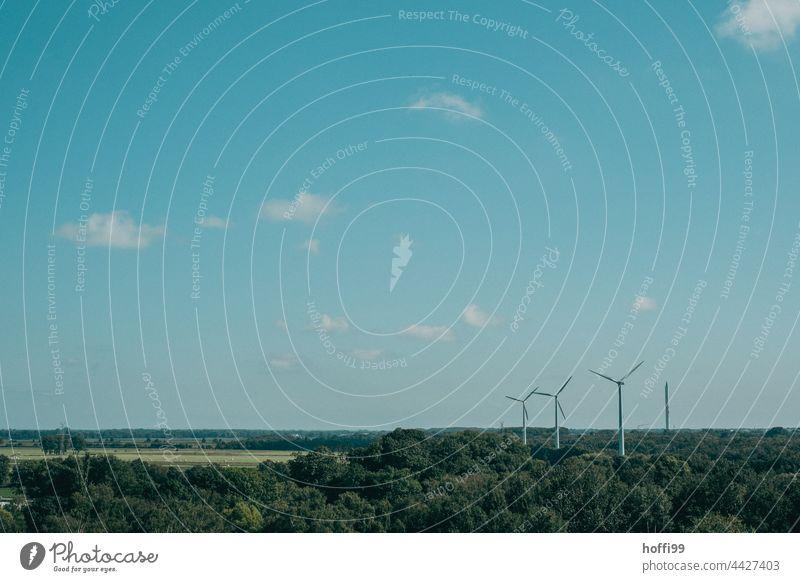 Wind turbines in the North German Plain windmills Wind energy plant wind power Pinwheel Energy industry Renewable energy Electricity Environmental protection