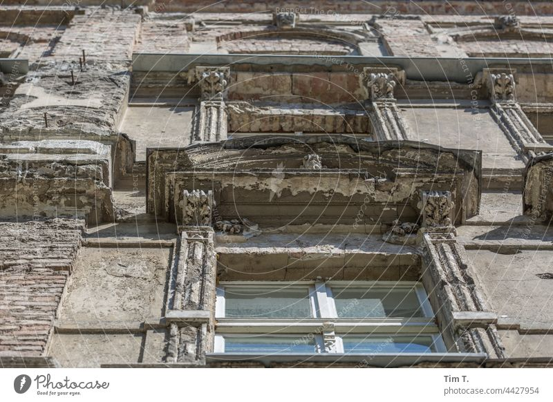 View upwards at an old facade with windows in Berlin Facade Old building Window Prenzlauer Berg Town Downtown Capital city Deserted Old town