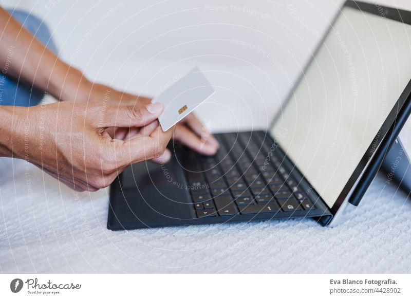 close up of unrecognizable woman doing online shopping with credit card and laptop. Technology and business concept caucasian human computer electronic bank