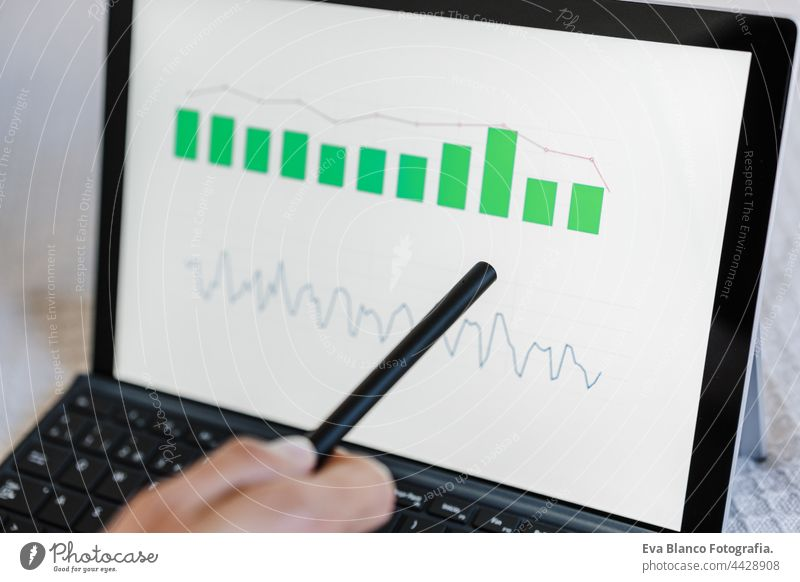 close up of Woman working on financial data with computer. Analyzing graphics and statistics on screen. Technology and business concept hand unrecognizable