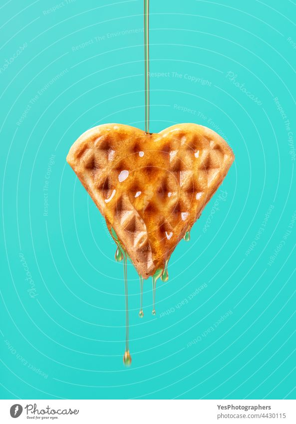 Waffle with maple syrup isolated on a green background. baked belgian breakfast brown cake calories caramel close-up color copy space cut out delicious dessert