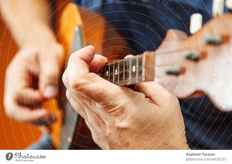 man playing the mandolin. hands closeup art artist professional performance concert musician entertainment melody classical concert rehearsal