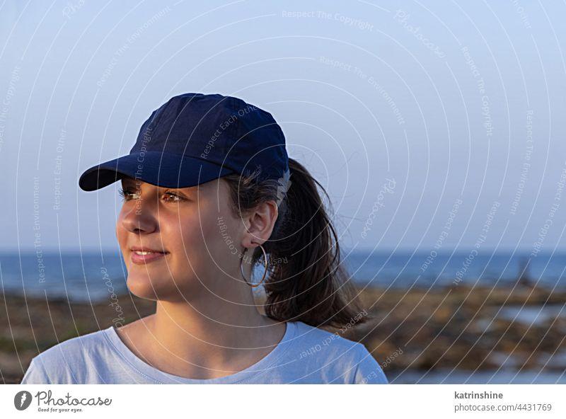 Teen girl in dark blue baseball cap at sunset outdoor teenager adolescent Caucasian mockup visor look aside head wearing teen girl childhood female happiness