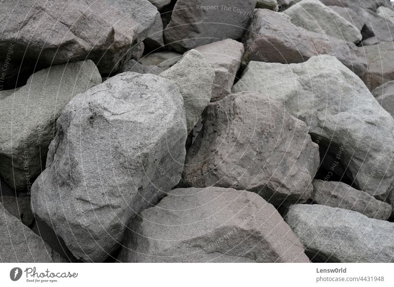 Big rocks along the coast of Iceland background big crushed dust excavation gray grey heavy material mine mineral pattern quarrying shape stone surface texture