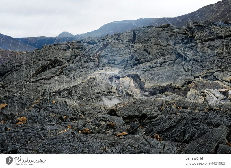 Lava field of Iceland's newest volcano, Geldingadalir black geldingadalir hot iceland icelandic landscape lava magma rock scenery smoke stone tectonic volcanic