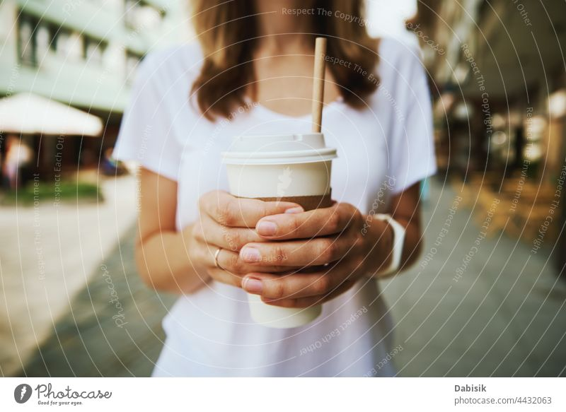 Woman walks at city street and drinks coffee to go woman cup paper casual relax freedom business girl urban model road person tea holding lifestyle takeaway