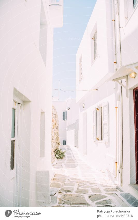 White architecture buildings in a small street, alley on Mykonos, Greece Architecture Alley Street Building houses Bright