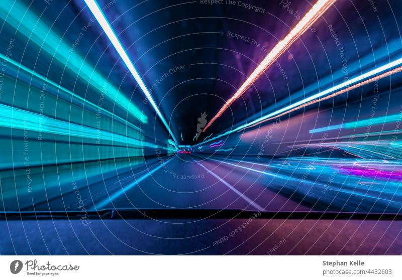 Highspeed underground drive - colorful concept for racing through the night and overtaking another car in a tunnel with motion blur effect. High speed