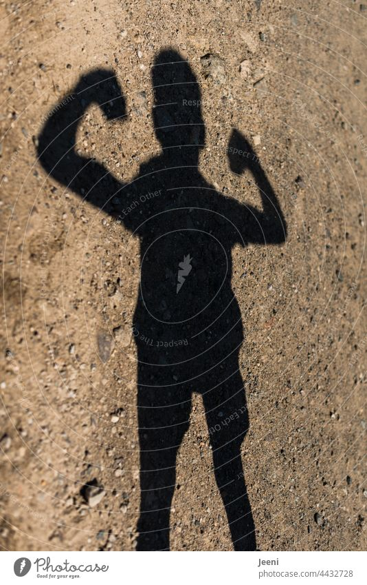 A shadow figure does strength exercises Human being person Man Woman Child Boy (child) Girl Shadow shadow cast Adults Youth (Young adults) Young man Infancy
