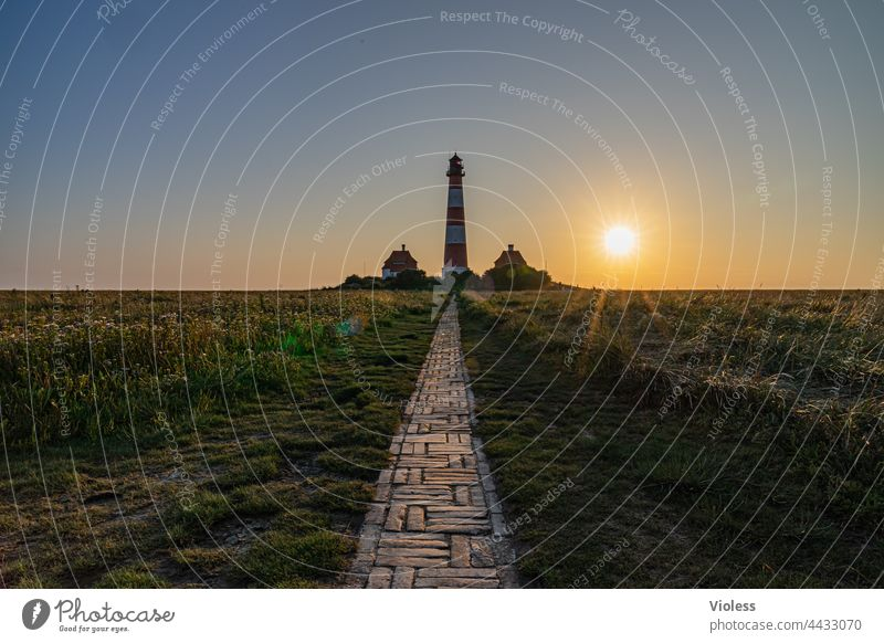 As the land, so the lighthouses Westerhever Lighthouse North Sea rays dazzling Blue coast Dark Westerhever lighthouse Landscape Tourism Vacation & Travel