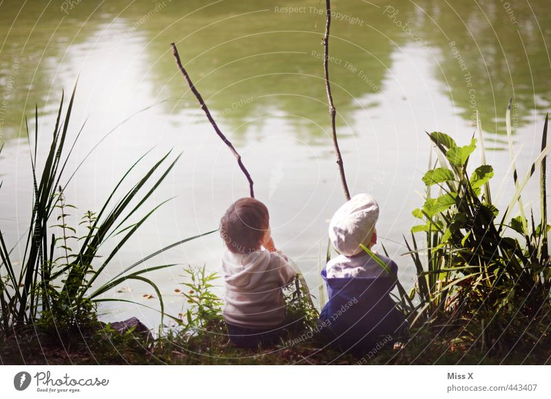 Human being Child Calm Emotions Playing Coast Lake Friendship Moody Together Park Leisure and hobbies Infancy Sit Wait Beautiful weather