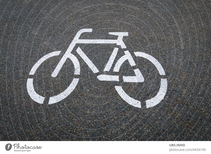 on the dark asphalt is painted the symbol of a white bicycle so that the cyclist keeps the lane Bicycle White Dark Gray Transport off Cycling Asphalt Street
