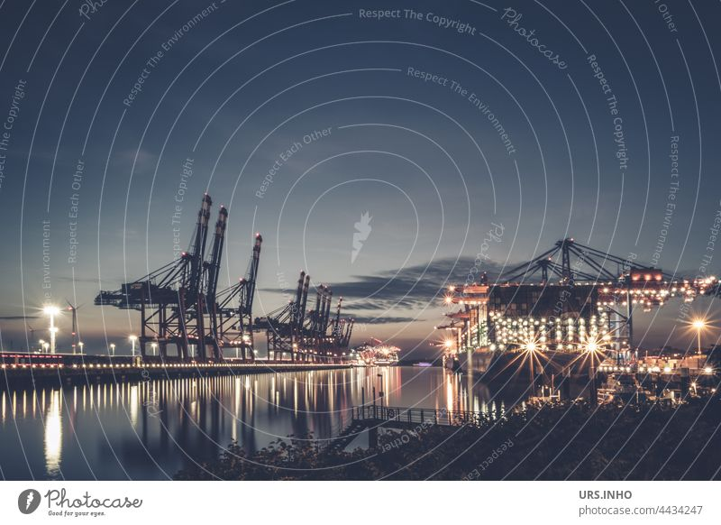 typical port scene at dusk with illuminated container ships and port cranes reaching high into the sky Harbour Harbour scene Container Container ship Industry