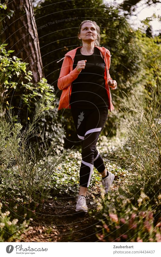 Sporty woman jogging in the forest Athletic Woman Nature Healthy workout Lifestyle Fitness Jogging Walking Sports Back-light Orange Sun Heathland pretty