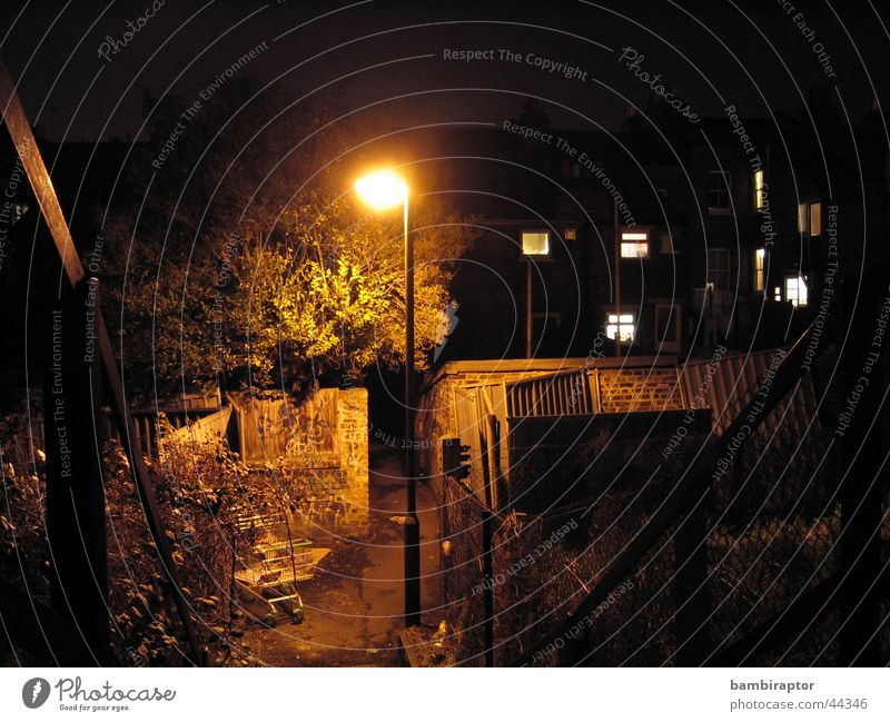 gas Slum area Fear Alley Curbstone Night Dark Lantern Shopping Trolley Trash Yellow Light No through road Gloomy Concern Panic Dirty Light (Natural Phenomenon)