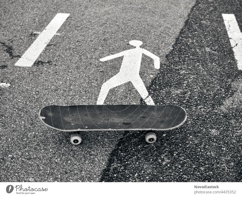 Pedestrian icon on a skate board, black and white image Icon Sign Road sign Signs and labeling Signage Warning sign Exterior shot Street Lanes & trails