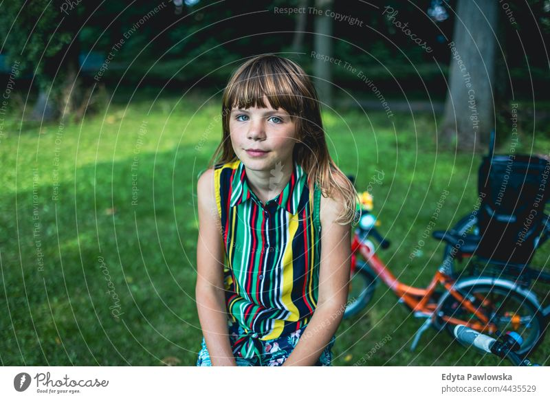Portrait of a girl with a bicycle in a park tree nature outdoors people adventure trees spring woods lifestyle recreation caucasian beautiful beauty bike child