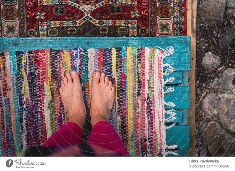 Bare feet standing on colorful carpets foot bare feet barefoot pattern art fabric texture old design decoration vintage persian textile oriental rug cloth craft