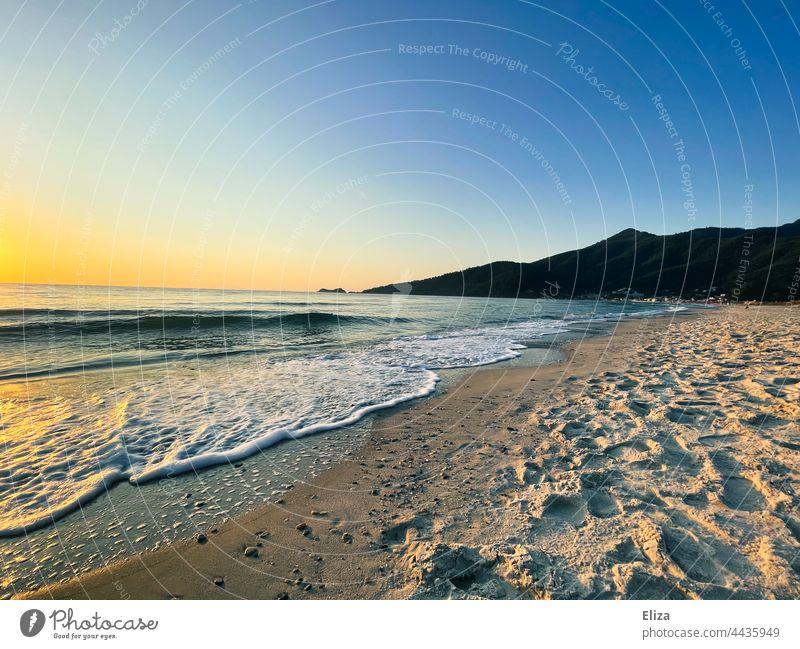 Beach and sea at dawn Ocean Dawn Landscape coast Nature Deserted Sky Sunrise Sandy beach Horizon mountains