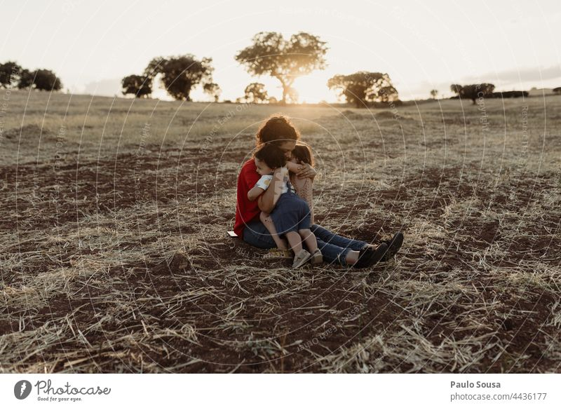 Mother with children in the fields Mother's Day motherhood Child Brothers and sisters Family & Relations Together togetherness Authentic Love Cute Caucasian