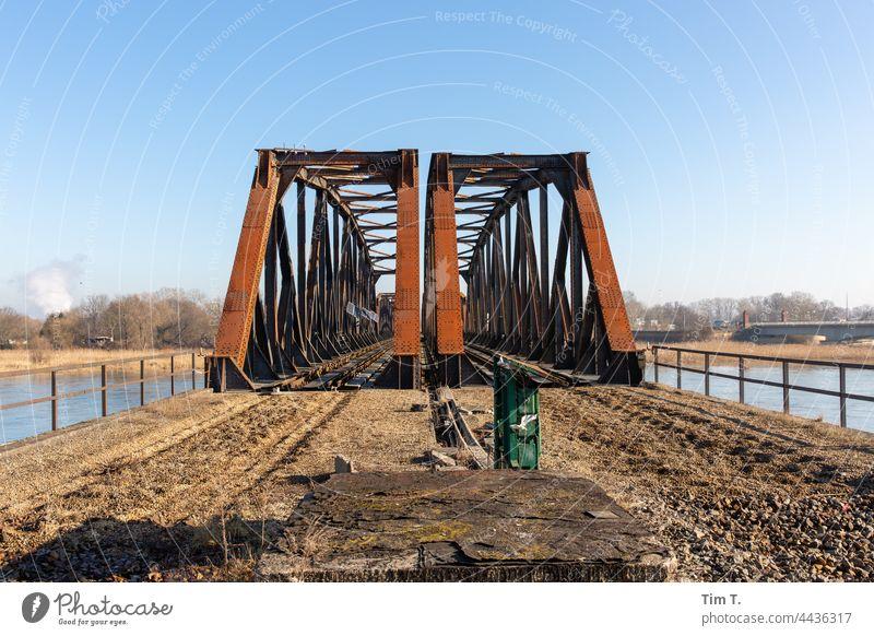an old rusty railway bridge over the river Oder Railway bridge Brandenburg Colour photo Exterior shot Bridge Deserted Architecture Day Traffic infrastructure