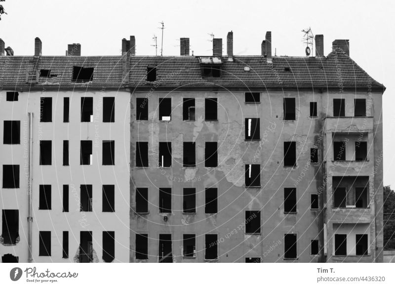 an old building where all the windows have been removed is standing blind Treptow köpenick Old building b/w Black & white photo Architecture Day Building