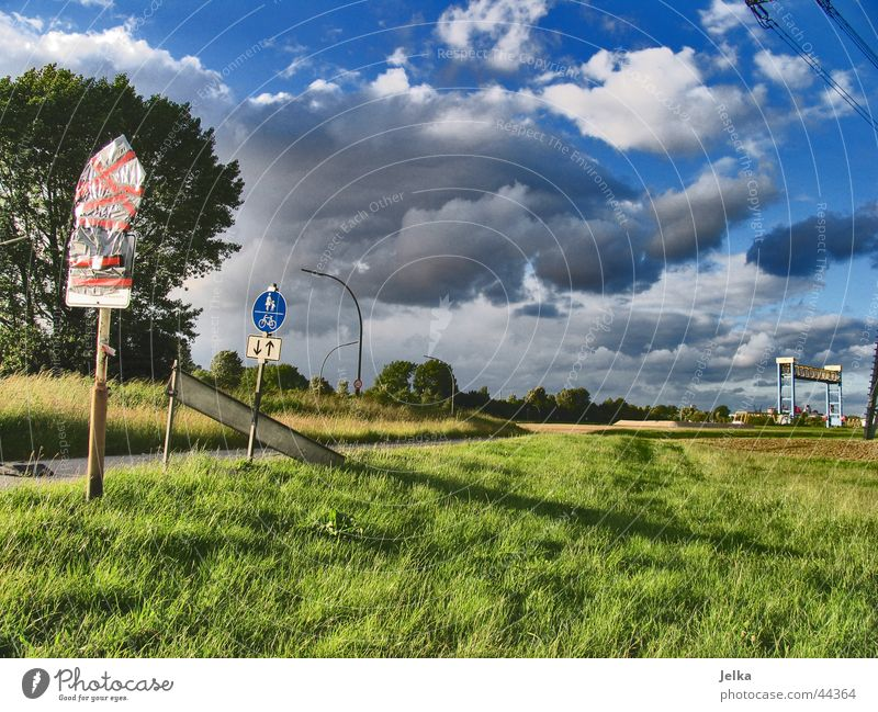 Sky Clouds Grass Wind Signs and labeling Threat Lawn
