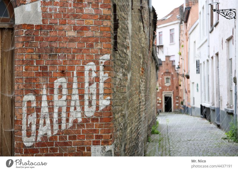 AltstadtGarage Architecture Building Facade Wall (barrier) Wall (building) Lettering Alley Town Characters Narrow Street Old town Lanes & trails