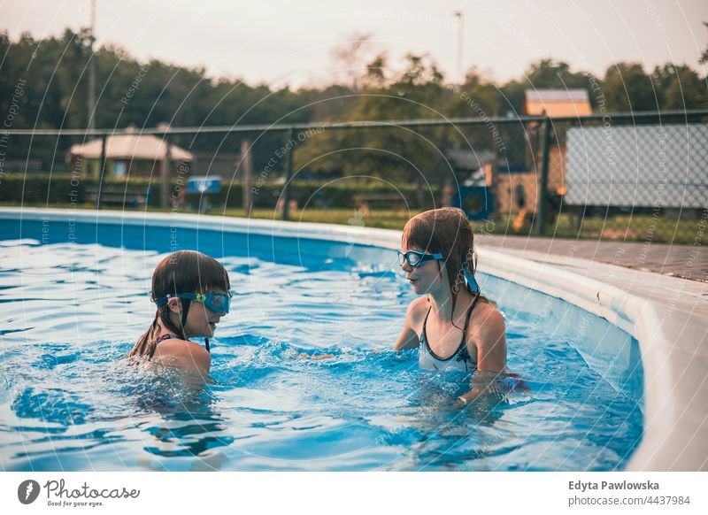 Children playing in the outdoor pool sport people health blue activity swim splash recreation resort swimming pool water holiday park active adventure beautiful