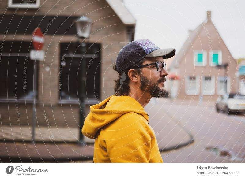 Man on the streets of a Dutch town adult architecture city fashion happy leisure lifestyle male man Netherlands outdoors people person portrait summer tourist