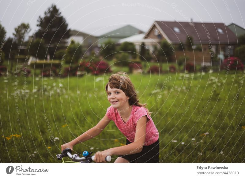 Little girl riding bicycle in the countryside Dutch Europe Holland Netherlands bike cycling riding bike cycle routes vacation travel active adventure summertime