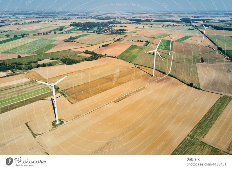 Windmill turbine in the field at summer day. Rotating wind generator energy windmill technology propeller sustainable landscape eco electric concept industry