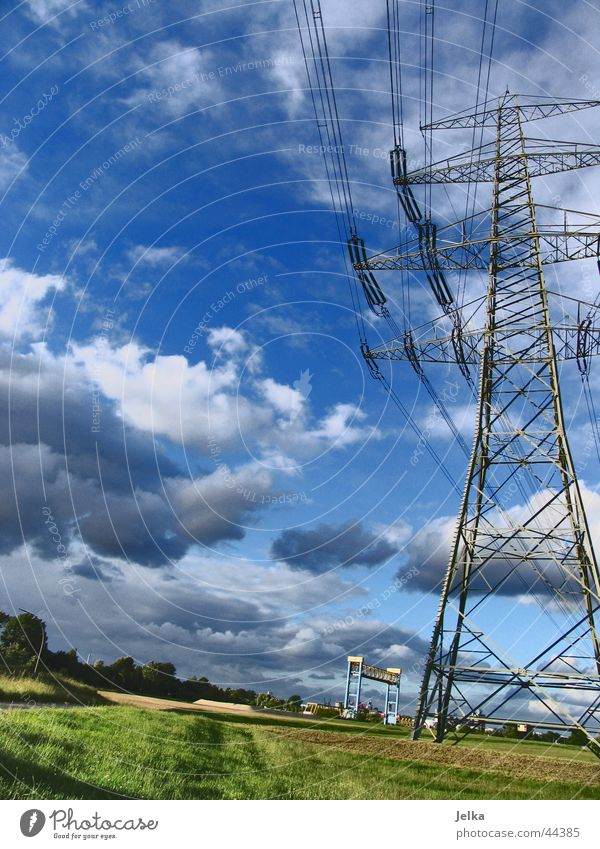 power pole Electricity Electricity pylon Conduct Transmission lines Clouds Blue Energy industry Cable Sky