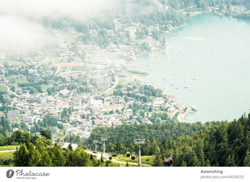 View of St. Gilgen Weather Fog Town Vantage point Lake Lake Wolfgang Cable car location Austria boats Forest Nature Landscape houses wide off Alps mountains
