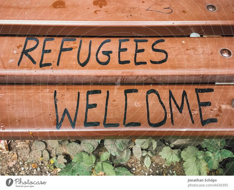 Refugees Welcome, refugees welcome as writing on a bench words Word Remark invitation Demand typography Typography Letters (alphabet) authored Text Characters