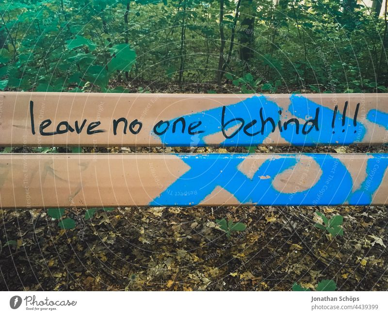 Leave no one behind!!!, leave no one behind as writing on a bench words Word Remark invitation Demand typography Typography Letters (alphabet) authored Text
