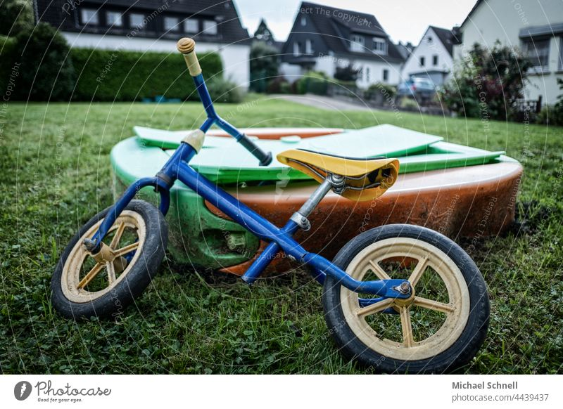 Old wheel, deposited at a sandbox for toddlers impeller Child Infancy Exterior shot Movement Toddler Bicycle Playing Former Past Review Longing melancholically