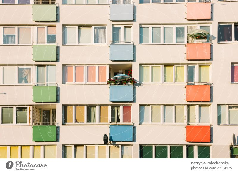 Pastel pink apartment building with a parasol on one of the balconies pastel Pink Apartment Building Architecture colorful Block Eastern Europe closeup