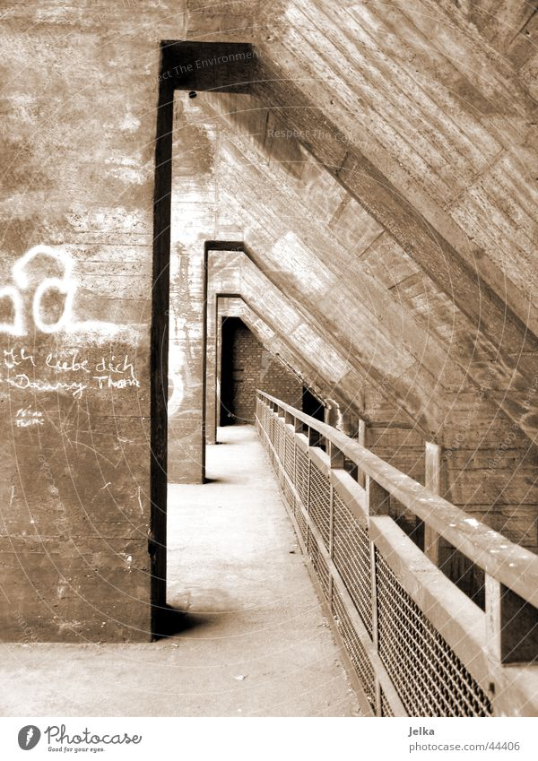 tunnel vision Industrial plant Factory Tunnel Manmade structures Architecture Concrete Brown Handrail Black & white photo Exterior shot Deserted