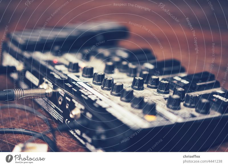 guitar effect board photographed on stage with open aperture - musician sound equipment sound board guitar effect footboard Guitar effect Effect device Stage