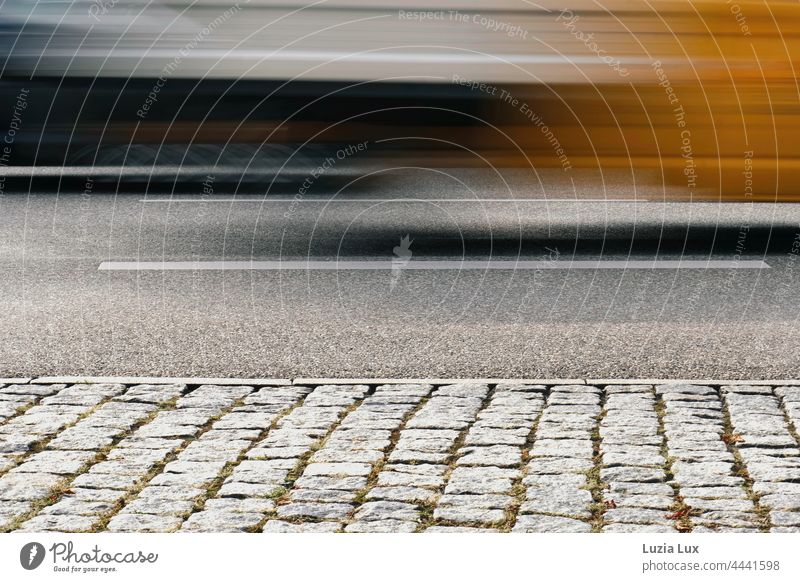 Federal road, speed and play of colours, autumnal Street Speed blurred Movement swift colors Cobblestones Grow hazy blurriness Transport urban Driving