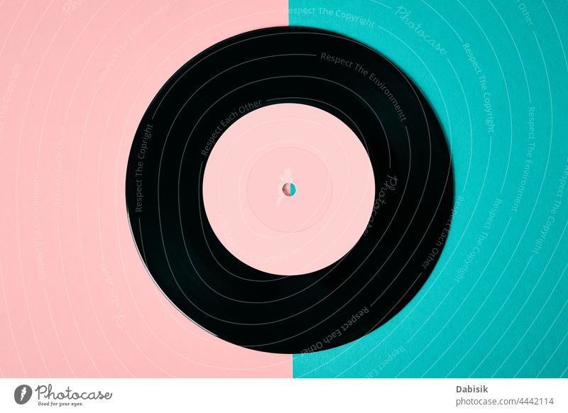 Old retro vinyl disc on colored background record music vintage audio entertainment sound old stereo melody disk black turntable disco label play closeup lp