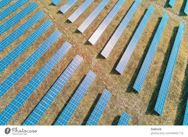 Solar panels farm in the field solar battery energy power sun alternative sustainable renewable plant photovoltaic ecosystem environmental green industry aerial