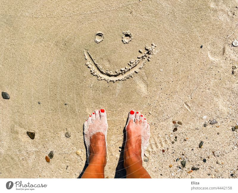 Sandy feet on the beach in front of a smiling smiley painted in the sand Beach Smiley Good mood vacation Joy Summer Vacation & Travel smilingly Contentment