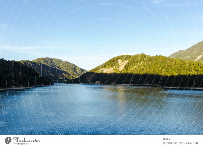 View over the Alps and the Sylvenstein Reservoir on a sunny summer evening Sunset at the lake Waterfront alps blue sky clouds copy space evening sun landscape