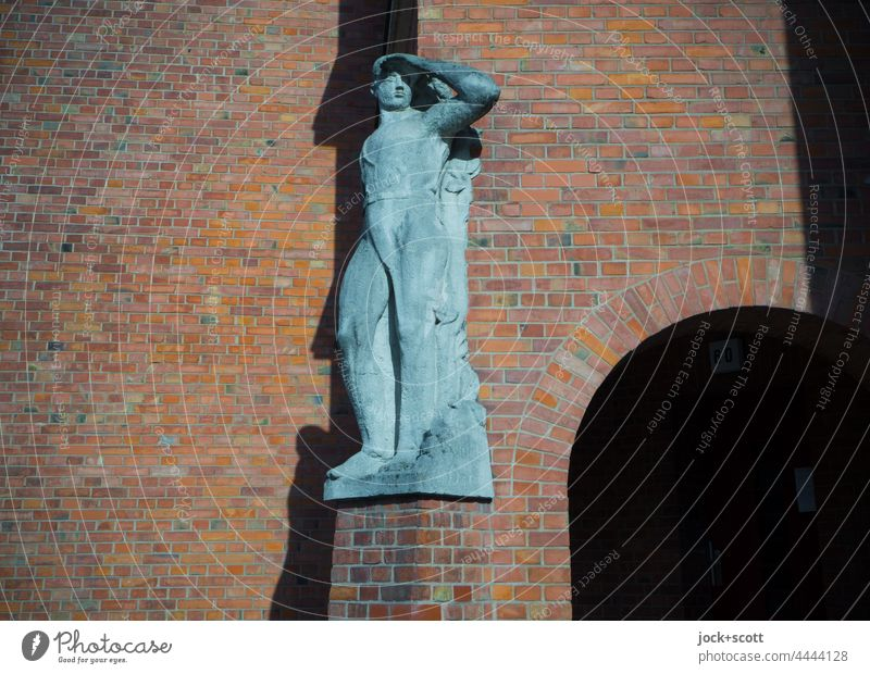 Stature in front of façade with clinker Statue Wall (building) Old Facade Sunlight