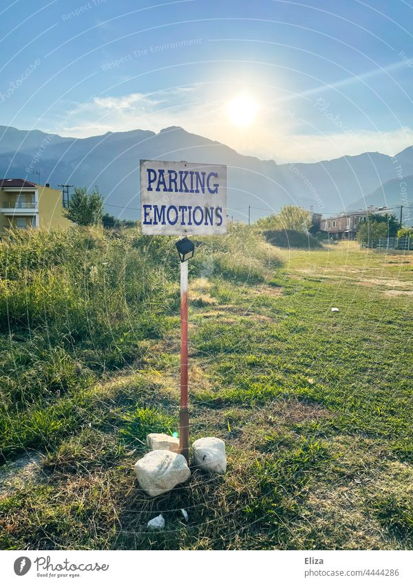 Parking Emotions is written on a sign in the landscape emotionally Landscape unfeeling Signage surreal Sun tranquillity stoic Rational Parking lot